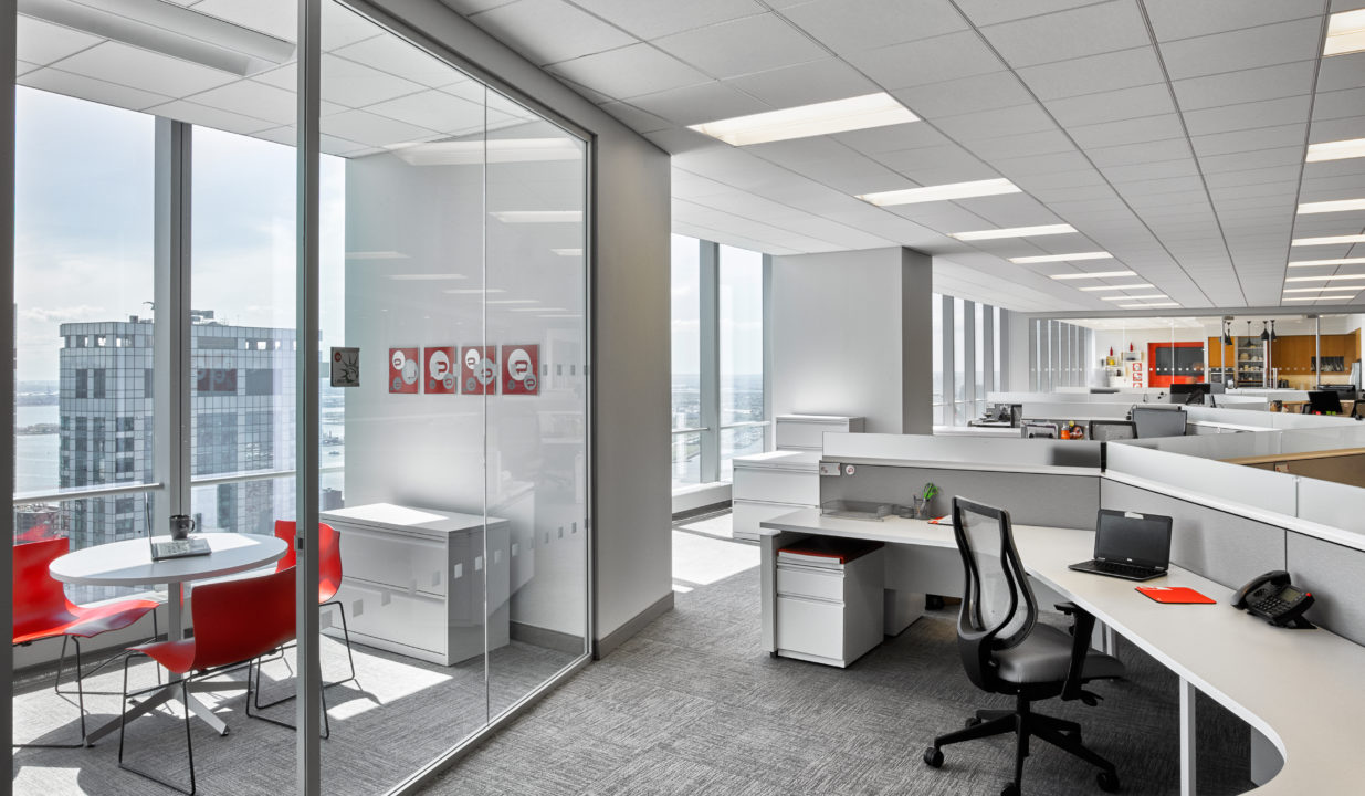 Open workstations with ample natural light. private offices with glass office fronts increasing line of sight.